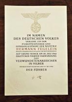 Наградной документ к знаку «За ранение 20 июля 1944 года» в серебре выписанный на имя группенфюрера СС Германа Фегелейна